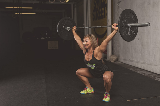 woman doing barbell overhead squat