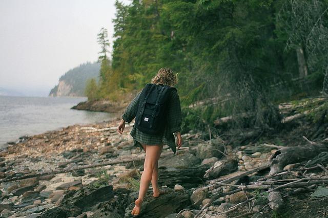 woman hiking barefoot
