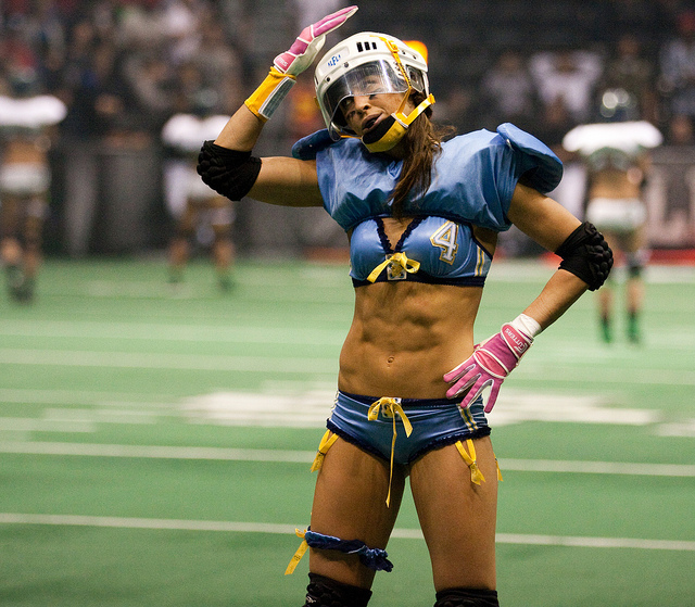 female football athlete with six pack abs