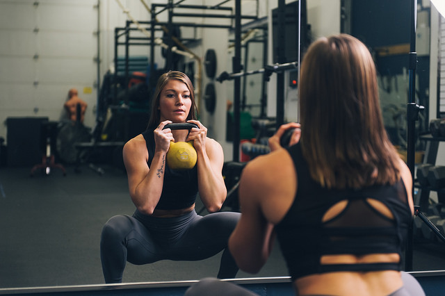 woman doing kettlebell goblet squats