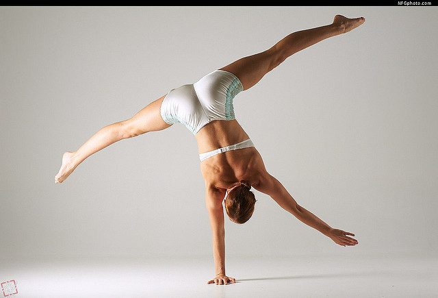 woman doing one-arm handstand