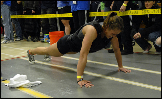 woman doing plank with weight vest