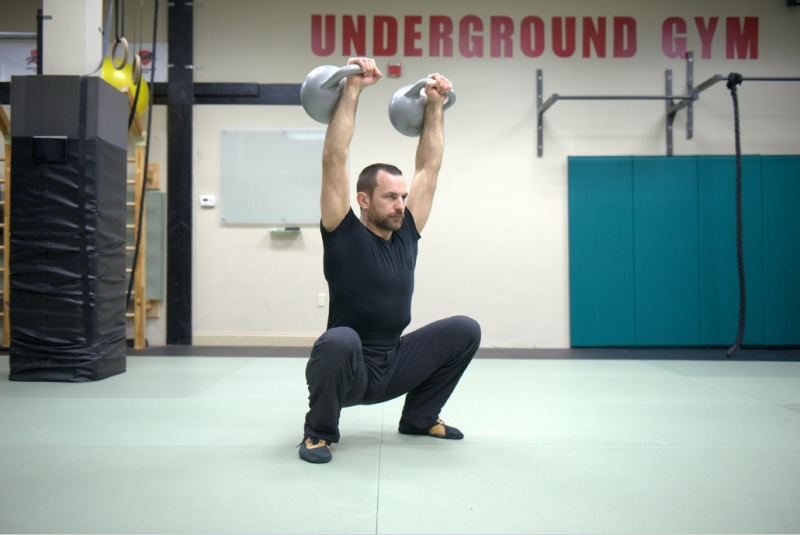 greg mihovich overhead squat with kettlebells