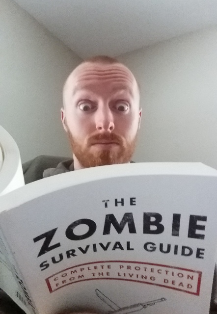john reading book about the zombie apocalypse