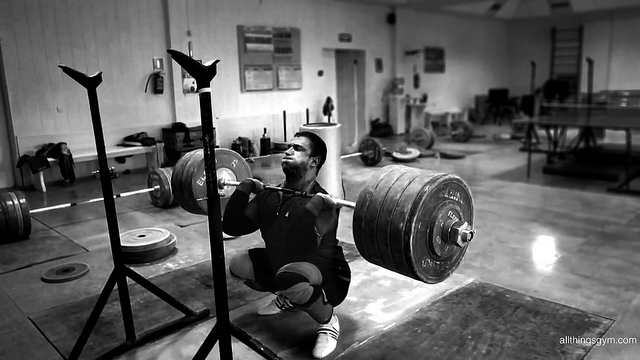 male weightlifter - barbell front squat
