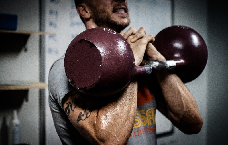 kettlebells in rack position