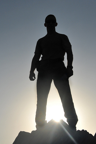 male silhouette on mountaintop