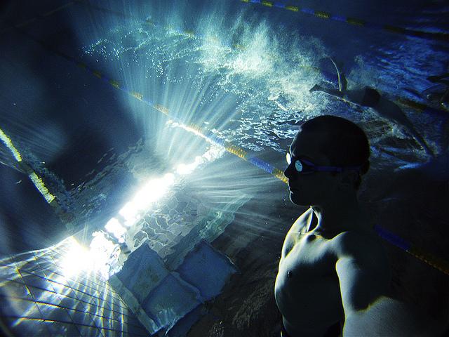 male underwater in pool