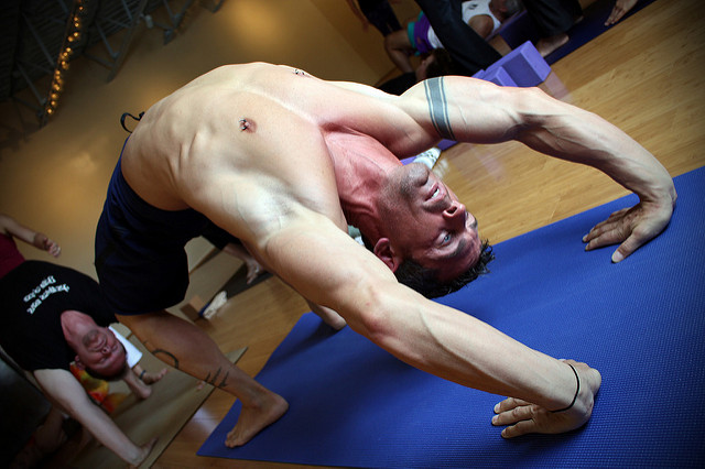 Beginner Level Bridge Exercise Progressions - Male in Yoga Class