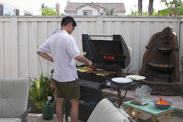 man cooking at bbq