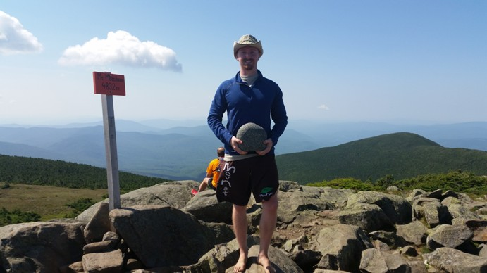 john atop mt moosilauke with stone in hand