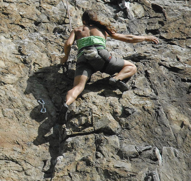 make things happen - rockclimbing woman